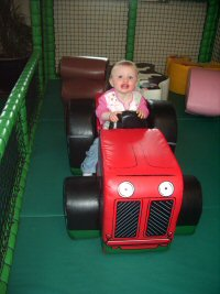Baby, Young Child on Tractor at Farmer Palmers
