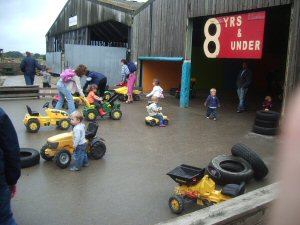 Tractor barn, with children driving the tractors