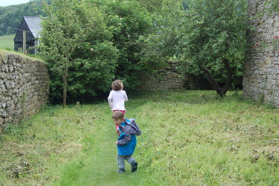 Stokesay Castle day out with the children - kids running around the moat walk